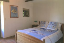 The ground floor double bedroom with direct access to the front garden