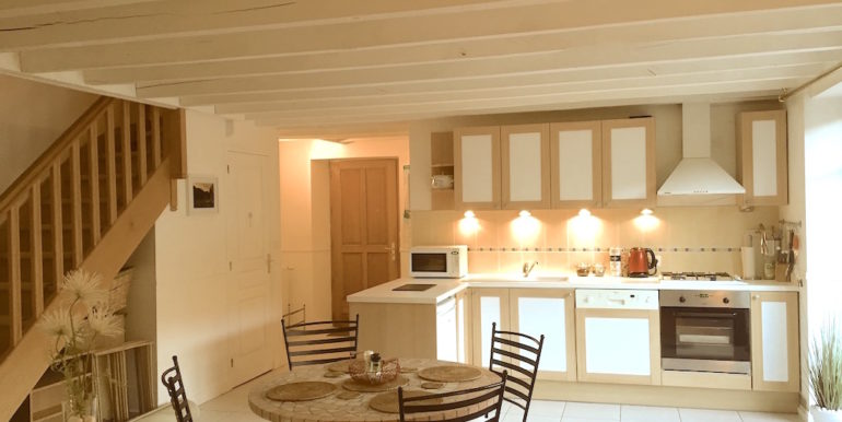 Light and spacious well equipped kitchen with direct access onto the sun terrance