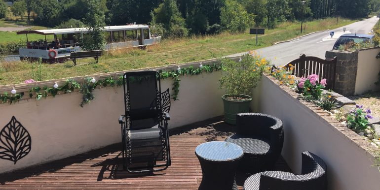 Decked patio area-just sit and relax and watch the boats go by....